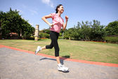 Pretty woman running outdoors — Stock Photo