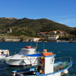 Small fishing boat in Port-vendres harbor - Stock Photo
