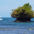 Rocky islet eroded by the waves — Stock Photo