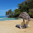 Lounger with parasol on a tropical beach — Stock Photo