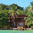 Tropical waterfront beach house — Stock Photo