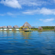 Tropical resort with thatched bungalows — Stock Photo