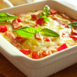 Casserole with cheese, bacon and tomatoes — Stock Photo #13900355