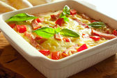 Casserole with cheese, bacon and tomatoes — Stock Photo