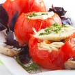 Tomatoes filling with spaghetti and cheese — Stock Photo #13990684