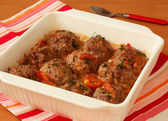 Meatballs with vegetables in white pan — Stock Photo