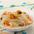 Salad of Chinese rice noodles and seafood — Stock Photo