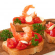 Toasts with tomatoes and shrimp — Stock Photo
