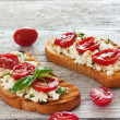 Toasts  with grilled tomatoes and ricotta — Stock Photo