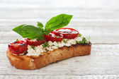 Toast with grilled tomatoes and soft cheese — Stock Photo