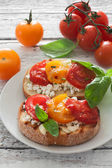 Toasts with soft cheese and cherry tomatoes — Stock Photo