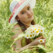 Portrait of child girl with bouquet of daisies — Stock Photo #46833355