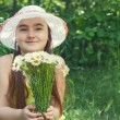Portrait of child girl with bouquet of daisies — Stock Photo #46833373