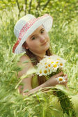 Portrait of child girl with bouquet of daisies — Foto Stock