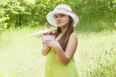 Child girl with bucket of strawberries — Foto Stock