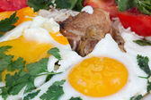 Fried eggs with meat and vegetables — Stock Photo