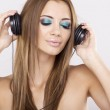 Beautiful girl is listen to the music — Stock Photo #12472493