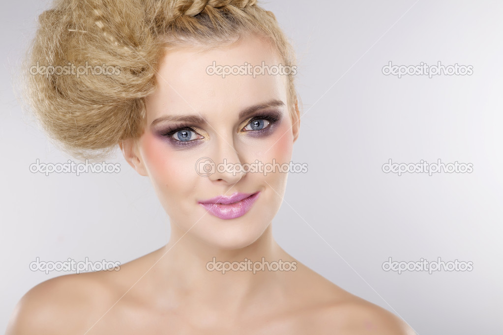 Young pretty woman with beautiful blond hairs and multicolor makeup isolated on white background — Stock Photo #12531982