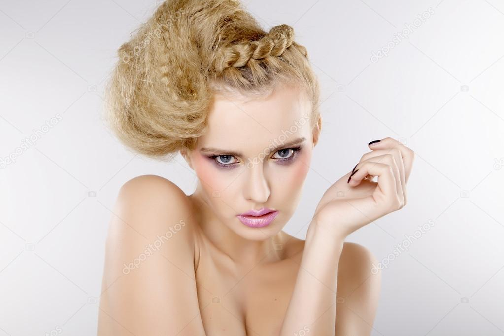 Young pretty woman with beautiful blond hairs and multicolor makeup isolated on white background  Foto Stock #12532050