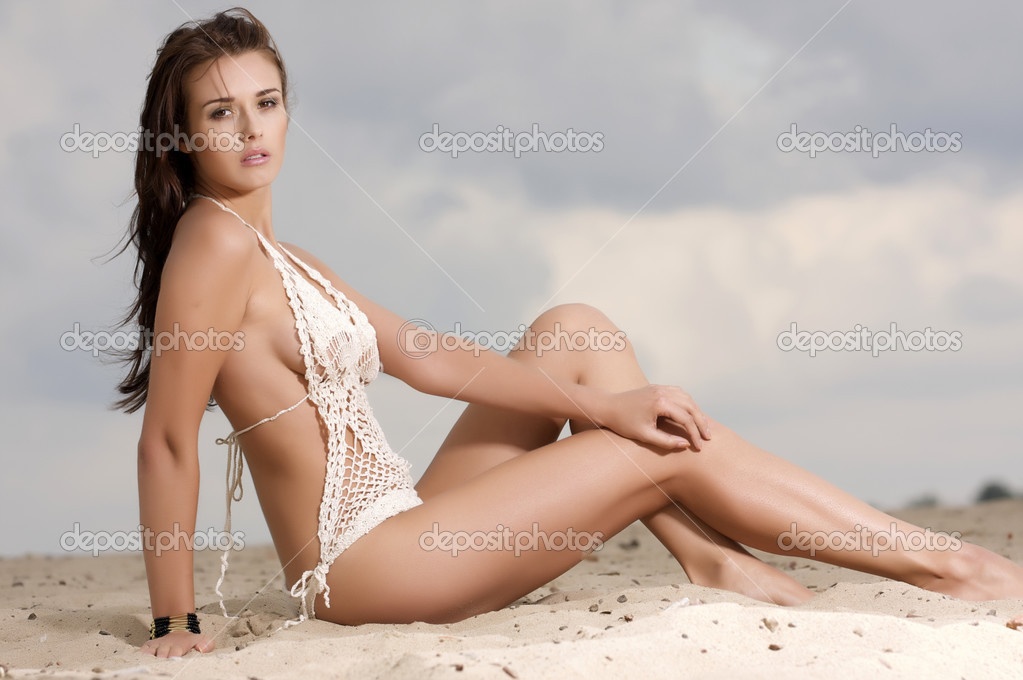 Young fashion pretty brunette sexy woman in white bikini on the beach  Stock Photo #13735714