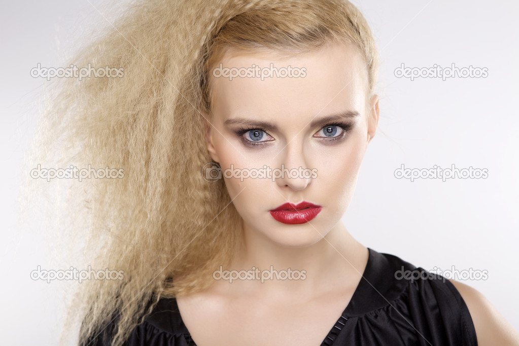 Young pretty woman with beautiful blond hairs and multicolor makeup isolated on white background — Stock Photo #13758666