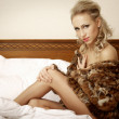 Blond woman in brown fur — Stock Photo #18409233