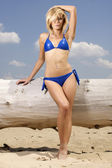 Beautiful blonde woman in blue bikini — Stock Photo