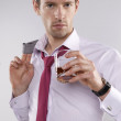 Handsome businessman after work drinking whiskey — Stock Photo #19924365