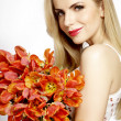 Beautiful blonde girl with the bouquet of tulips isolated on a w - Photo