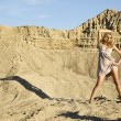 Attractive and sensuality woman in the desert — Stock Photo