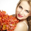 Beautiful blonde girl with the bouquet of tulips isolated on a w — Stock Photo #28072903