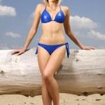 Beautiful blonde woman in blue bikini — Stock Photo #28343673