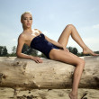 Stock Photo: Beautiful blonde woman in black swimwear