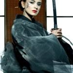 Beautiful japanese kimono woman with samurai sword — Stock Photo #30780891