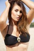 Portrait of beautiful brunette woman in black bikini — Stock Photo