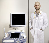 Portrait of young male technician operating ultrasound machine — Stock Photo
