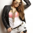 Beautiful adult sensuality woman in black jacket and sunglasses — Stock Photo