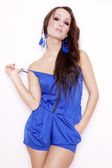 Sexy brunette posing in blue dress. — Stock Photo