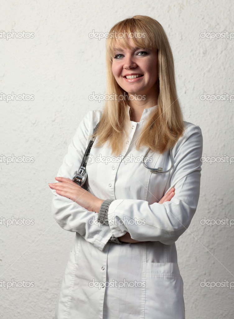Female doctor smiling on the white background. — Stock Photo #13913089