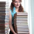 Young student woman with lots of books. — Stock Photo #14119892