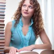 Young student woman with lots of books. — Stock Photo