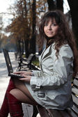 Young business woman with laptop. — Stock Photo