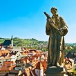 Statue over a city - Stock Photo