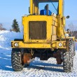 Big tractor on snow — Stock Photo