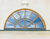 Half-round window in old house — Stock Photo