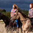 Girls and horses - Stock Photo