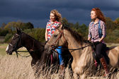 Girls and horses — Stock Photo