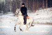 Man on horseback — Stock Photo