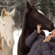 Asian girl and two horses — Stock Photo