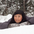 Asian girl in mittens — Stock Photo